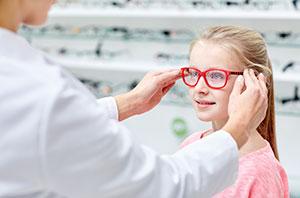 child trying on eyewear